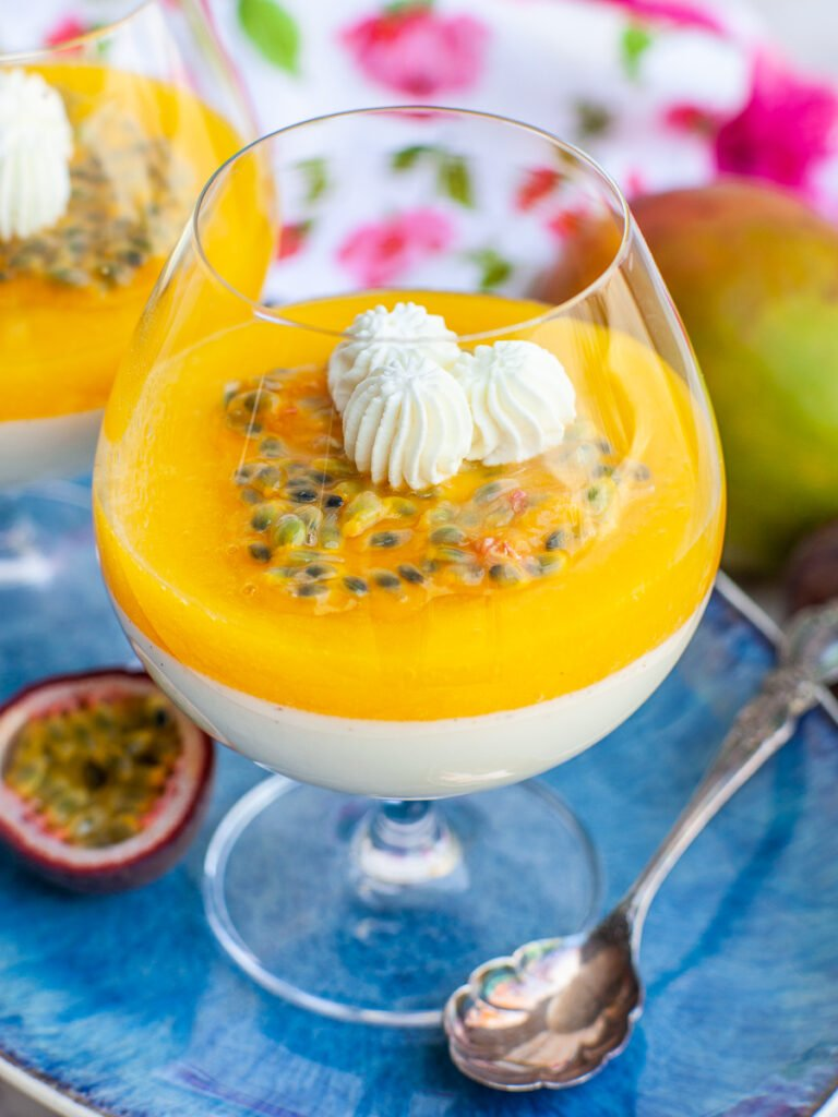 close up of vanilla panna cotta with mango and passion fruit