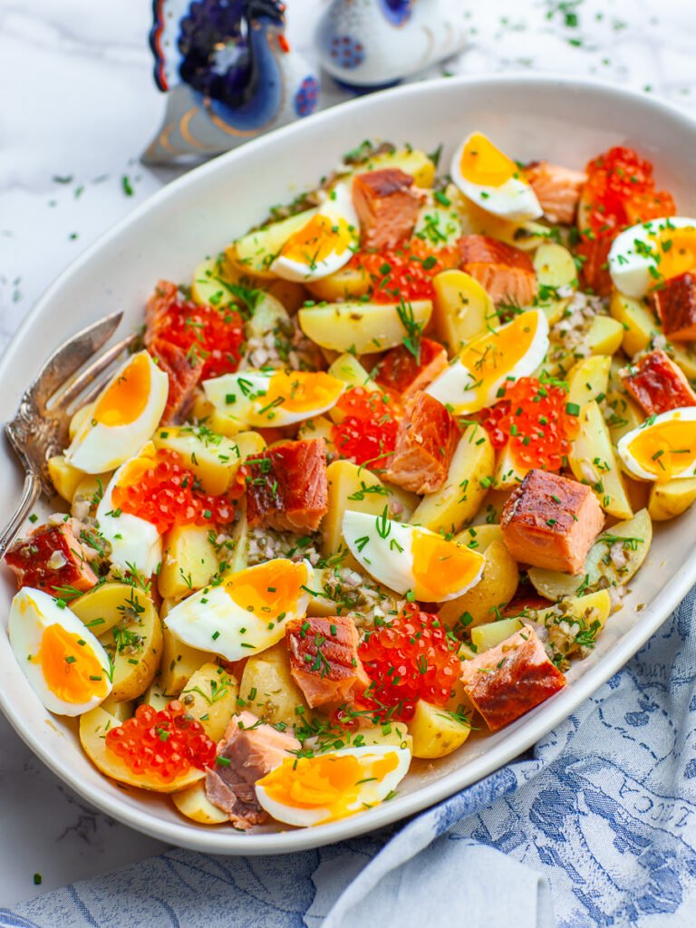 smoked salmon salad with 7-minute egg and salmon with caviar and dill