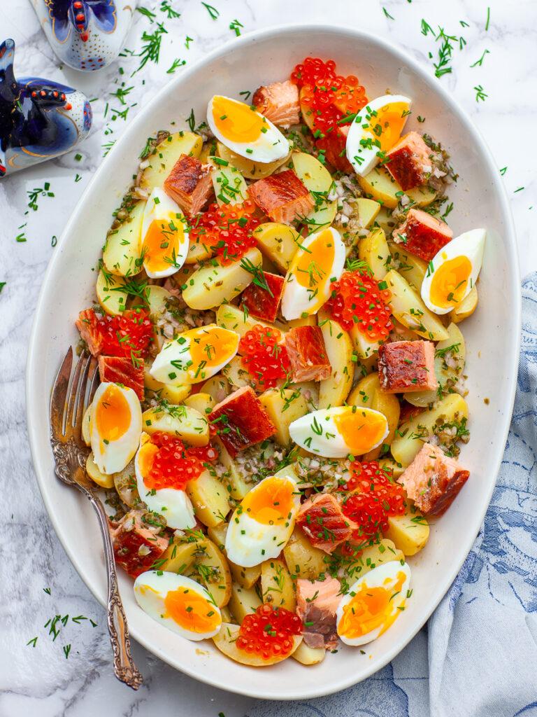 potato salad with hot smoked salmon, eggs, salmon roe and lemon dressing