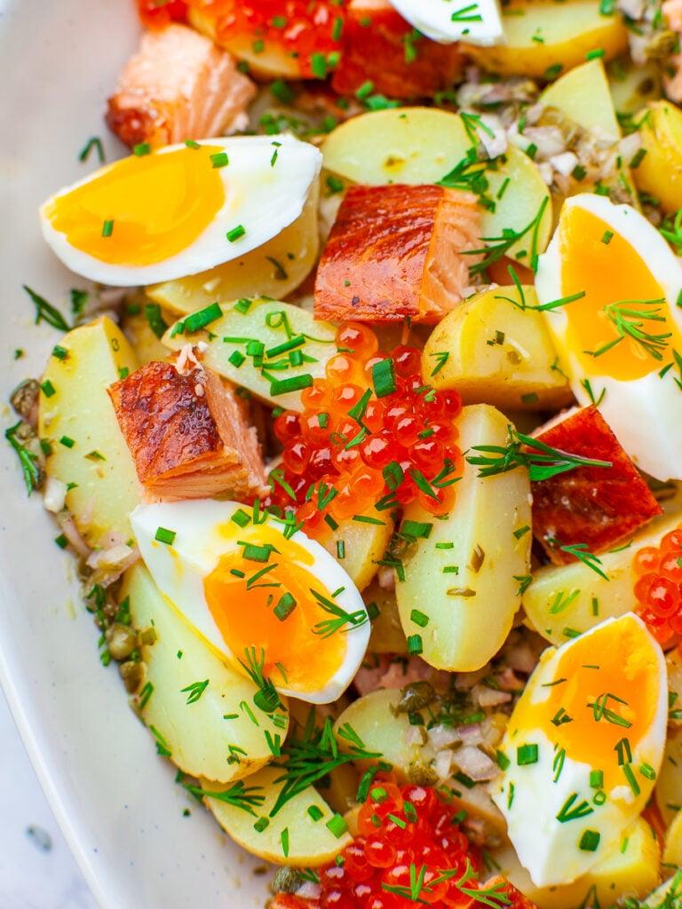 baby potato salad with salmon venison, liquid egg and smoked salmon