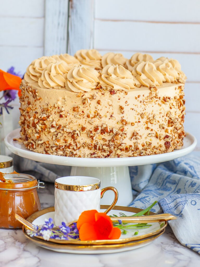 caramel cake with diced pecans and caramel frosting