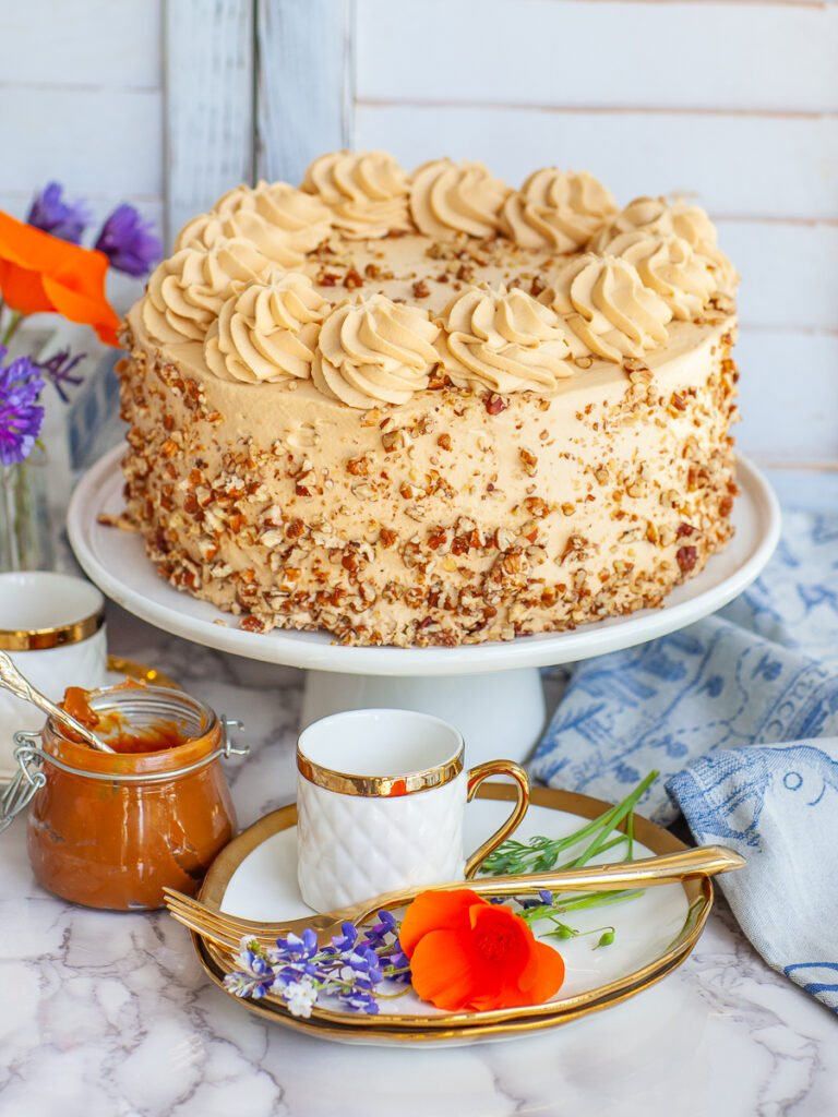 Golden Key Caramel Cake with caramel whipped cream and diced pecans