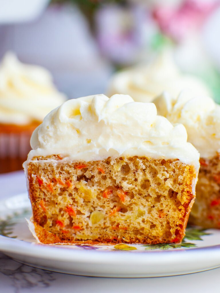 inside slice of carrot cake cupcakes with cream cheese frosting