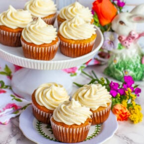 cupcake stand with frosted carrot cake cupcakes