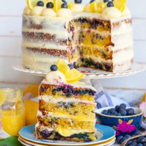 slice of blueberry lemon cake with cream cheese frosting