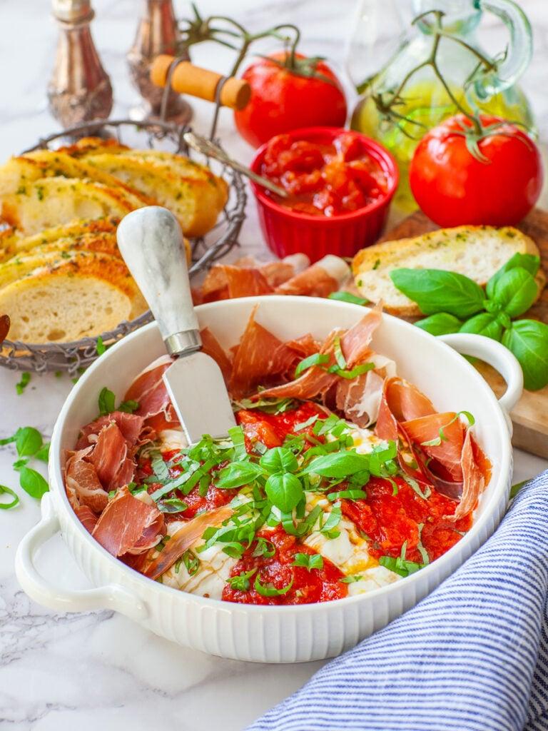 burrata bruschetta with fresh basil and prosciutto