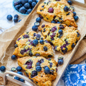 large, fluffy blueberry scones with fresh blueberries and sugar crystals