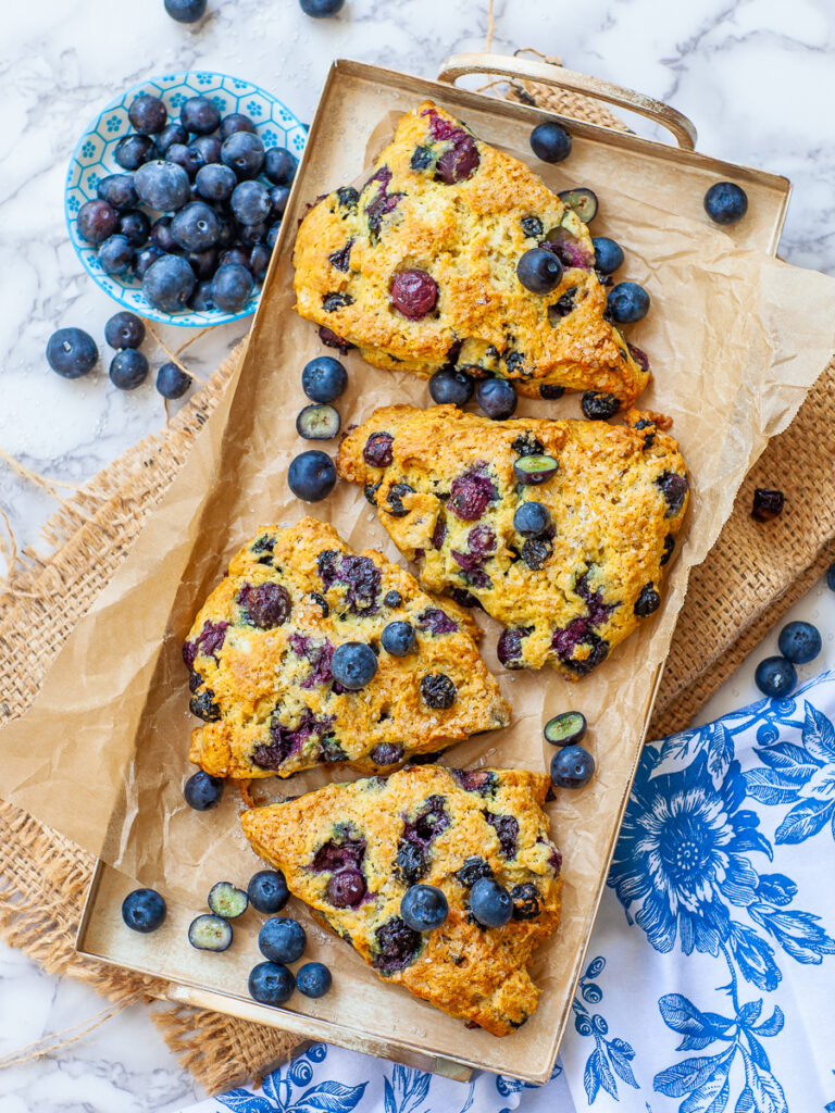 bakery-style blueberry scones on serving tray