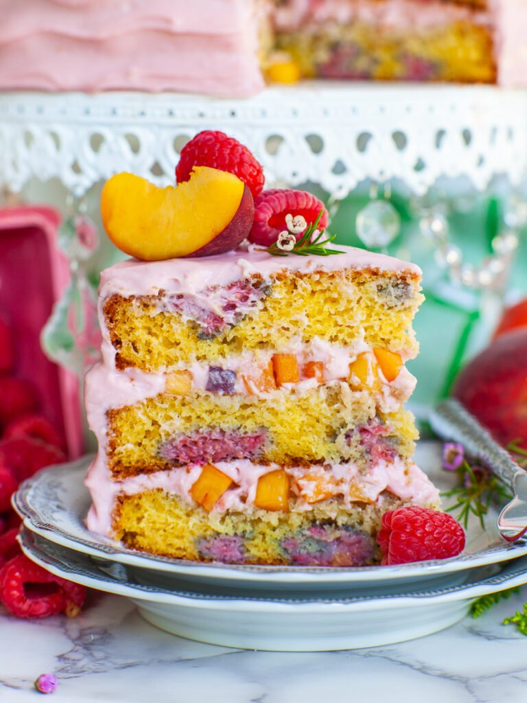 slice of raspberry cake filled with peaches